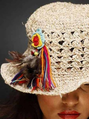 Hemp hat with a funky rainbow attachment of wool strands and crochet flower.