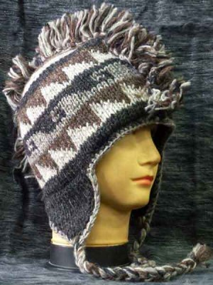 Mohican sherpa hat in earthy browns and black, lined with fleece.