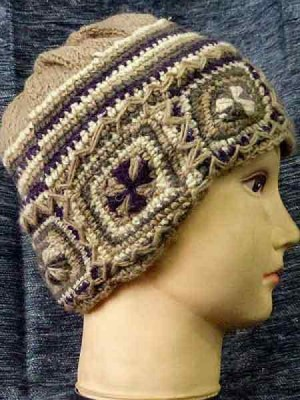 Wool beanie with crochet patterns and lined with fleece