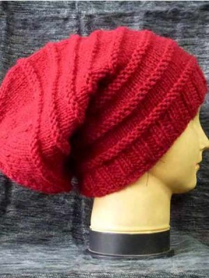 A red slouch beanie made in Nepal.