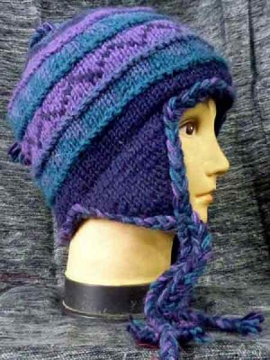 A wool sherpa beanie in tones of blue and lilac, lined with fleece and made in Nepal.