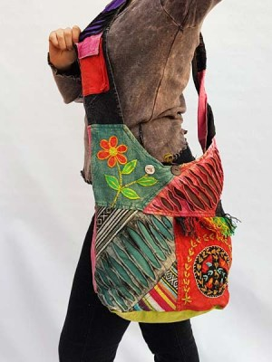 Razor cut and patch flower hippie hobo cross shoulder bag.