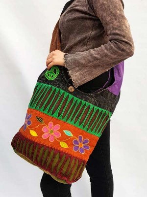 Shoulder jogi bag with patch flowers and razor cutwork in hippie, bohemian style