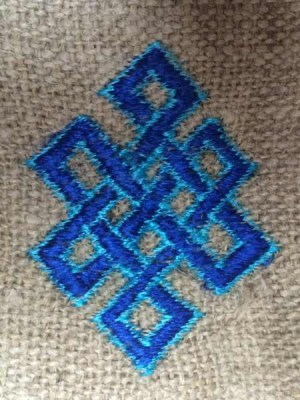 Hemp wallet with endless knot embroidery