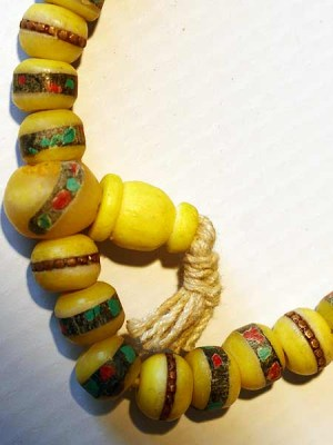 Yellow bone mala necklace made from 108 beads