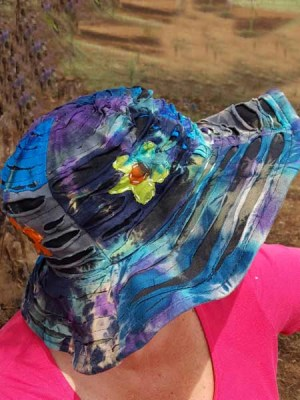 Tie-dye hat in bohemian style with razor cut and patch flowers