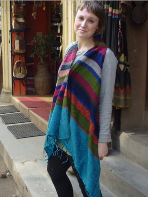 Sleeveless striped poncho made in the Himalaya's