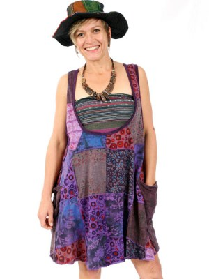 A low cut neckline for this patchwork grunge dress. The perfect bohemian loose fitting garment for summer.